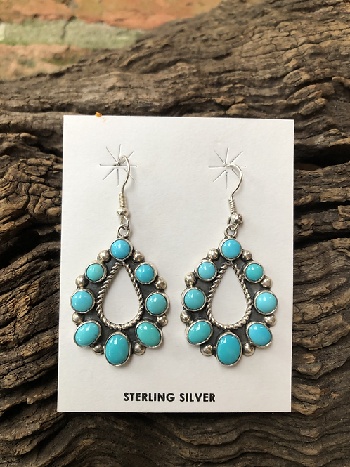 Polished cut turquoise stones set into sterling silver on french wires