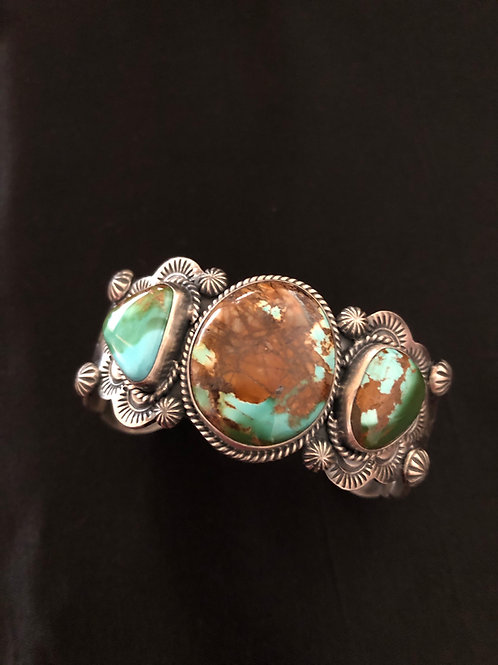 Navajo hand tooling and stamp work with 3 turquoise stones by Bernyse Chavez
