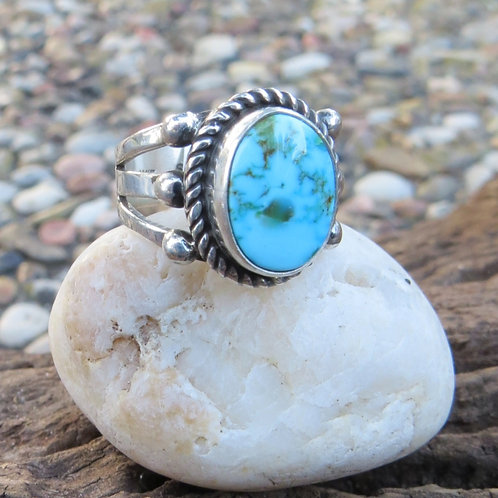 Navajo sterling silver ring with turquoise stone, signed HBM. Size 6.75