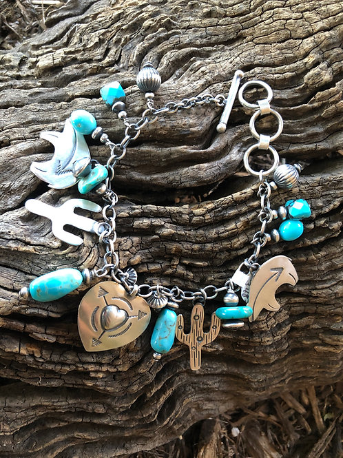 Multi-stone charm bracelet with cacti, bears and heart pendant