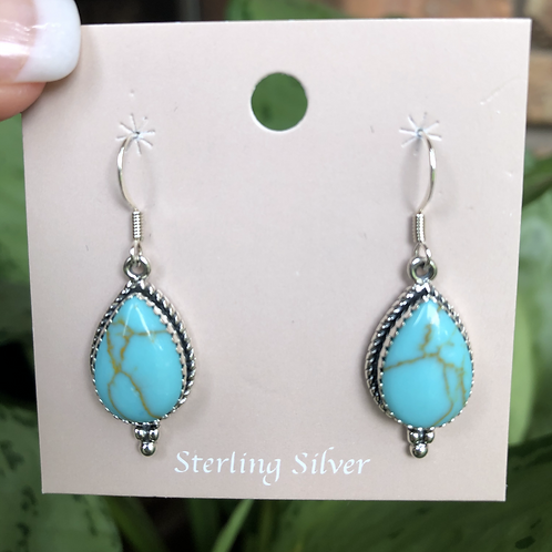 Turquoise dangles set in sterling silver on french wires.