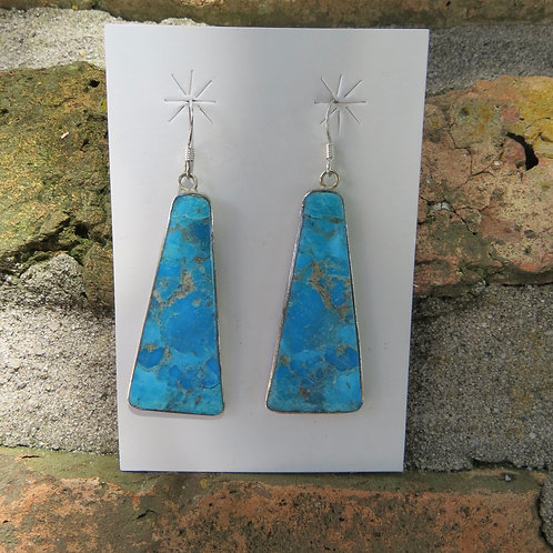 Turquoise triangle shape earrings set in silver mounting by Veronica Tortalita
