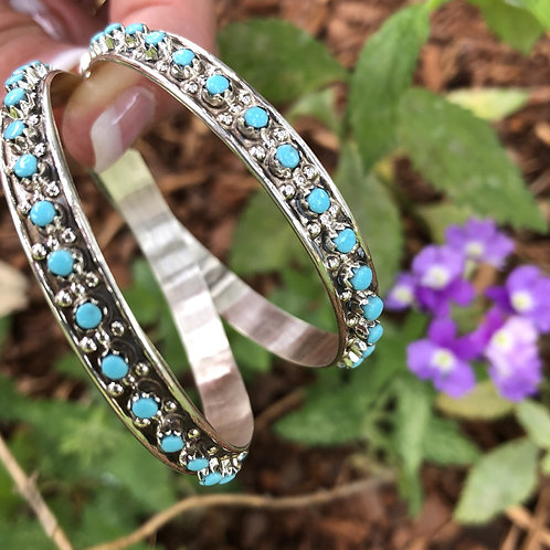Zuni turquoise snake eye set into sterling silver hoops by Joann Cheana