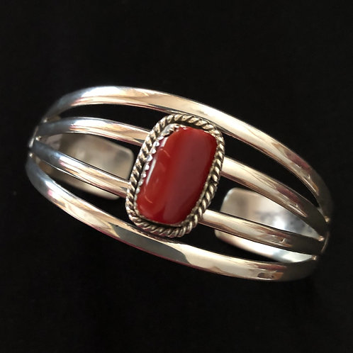 Navajo sterling silver bracelet with blood red coral stone, signed WB