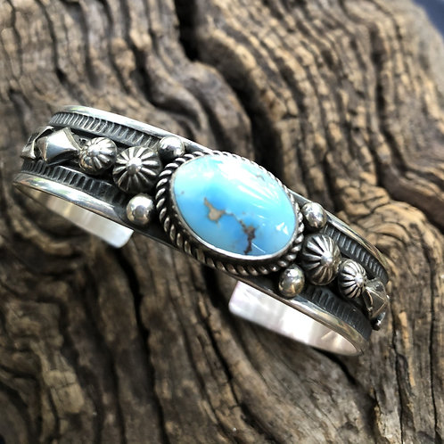 Golden Hills turquoise cuff set into intricate sterling silver designs, signed.