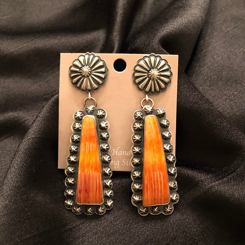 SOLD- Sterling silver stamp work  with orange spiny dangles, signed.  $ 275.