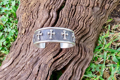 Sterling silver cuff with 8 crosses