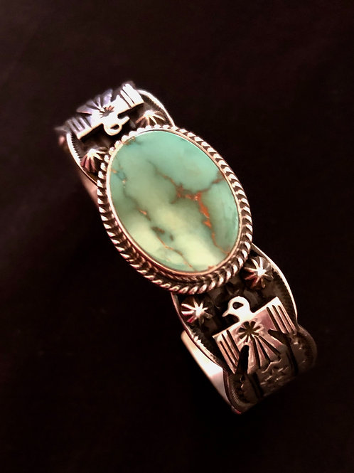 Navajo sterling silver thunderbirds and stamp work with royston turquoise stone.