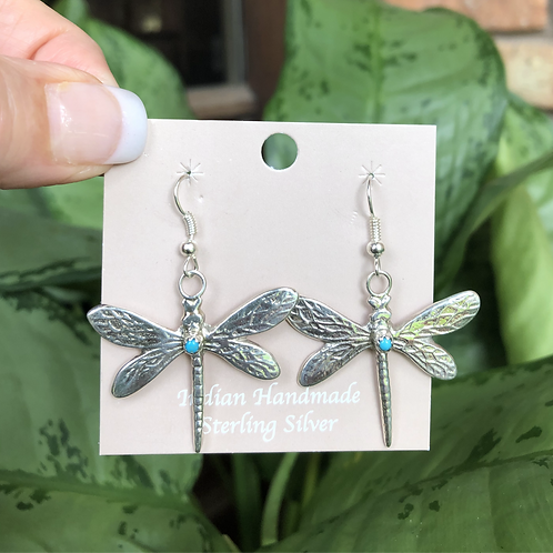 Sterling silver dragonfly earrings with turquoise stones by Pauline Nelson.