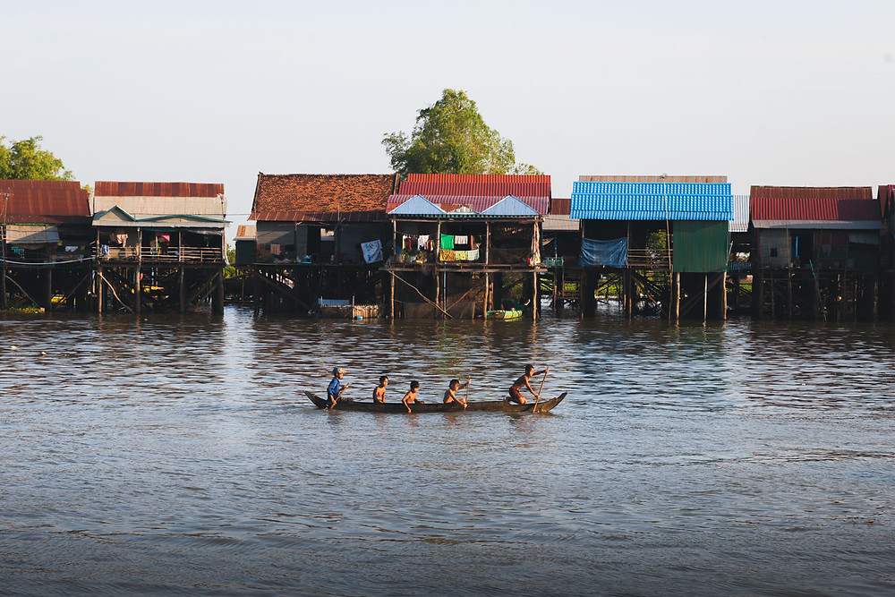 Children Paddling through Kampong Khleang