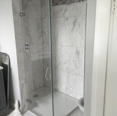 frameless glass shower in bathroom.png