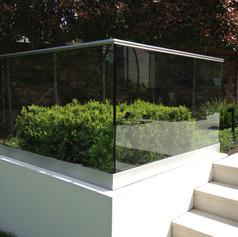 glass balustrade in a garden.png