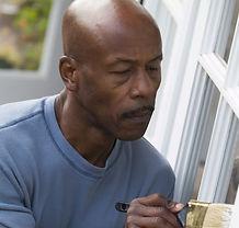 man painting a door outside.jpg