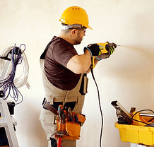 man drilling into a wall.jpg