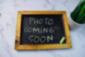 Photo Coming Soon write on a chalkboard