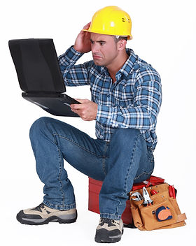 Confused builder sat with laptop.jpg