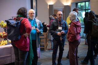 Troy talking with Lynn Riddiford during the Cold Spring Harbor Drosophila Neurobiology Meeting, 2019