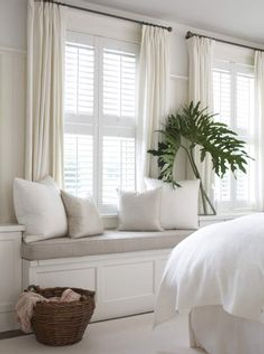 tier on tier window shutters with curtains