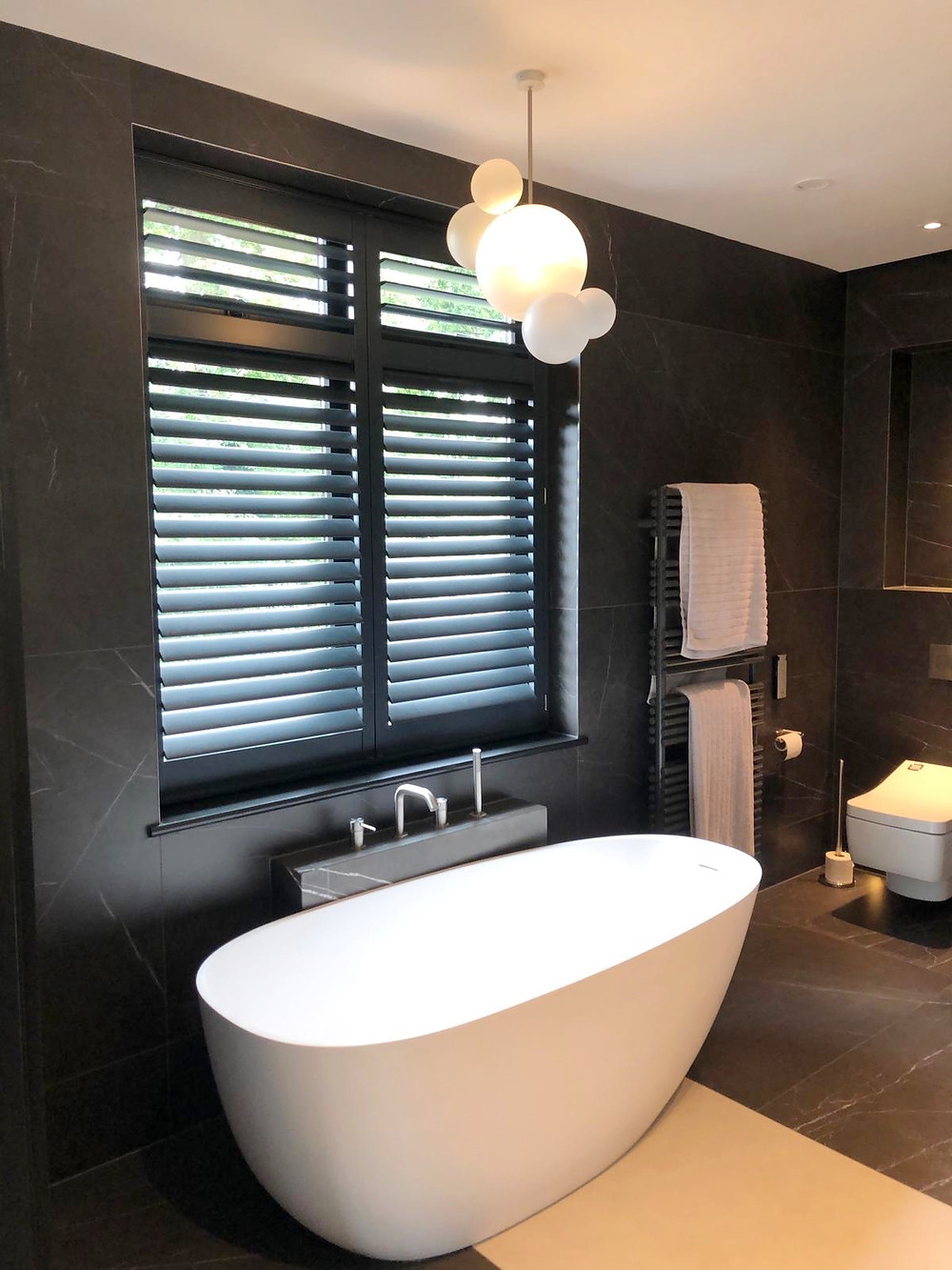 Black bathroom shutters