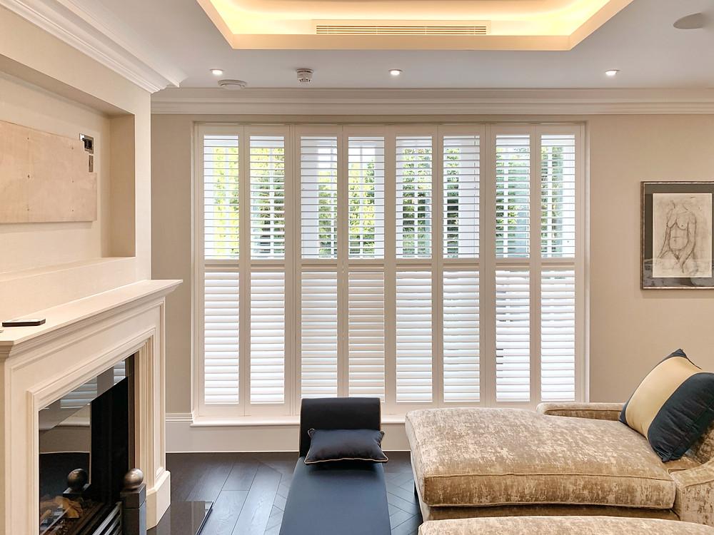 Full height living room window shutters
