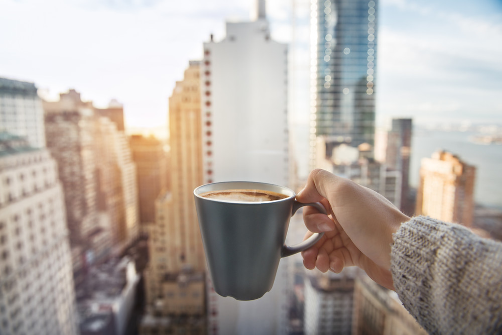 Cup of Coffee with city backdrop