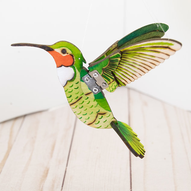 Whimsical small wooden pyrography hummingbird mobile with green, orange and yellow watercolor