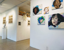 Art exhibit in our front gallery featuring Industrial Quilts and Artful Harper Studios
