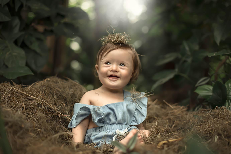 Retrato de bebê com síndrome de down