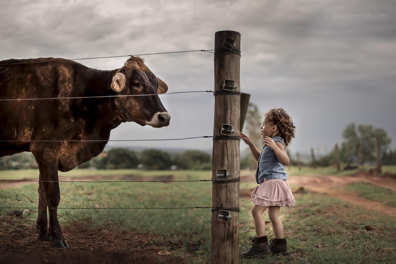 Isabele no seu ensaio na fazenda