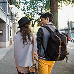 Couple Walking on Urban Sidewalk