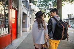 Couple Walking on Urban Sidewalk