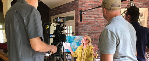Edie Hand is surrounded by Dill Productions Filming crew for Women of True Grit series