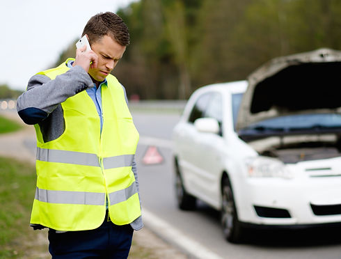 Man calling car towing service on a high