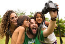 Brazilian tourists taking selfie photos