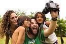 Brazilian tourists taking selfie photos