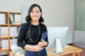cheerful-businesswoman-FUGXP89.jpg