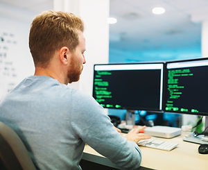 portrait-of-young-programmer-working-in-