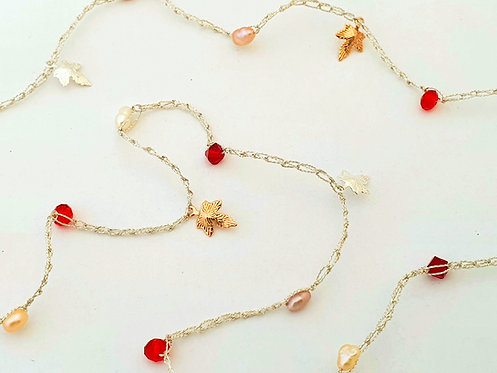 Warm color pearls & Red Swarovski Crystals with charms