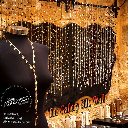 Silk necklaces hang in the store