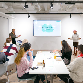 Lola and I presenting at the NYT Level Up Workshop with Broadgate for IWD 2020