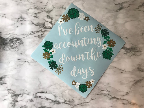 I've been accounting down the days grad cap
