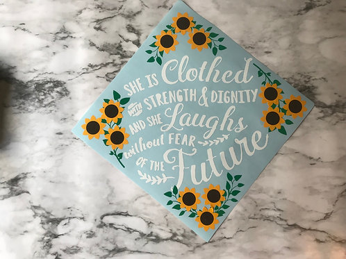She is clothed grad cap