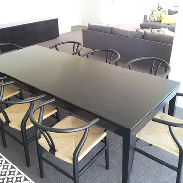custom made dining table in black Japan finish for in a Brisbane residence
