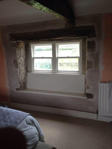 Traditional lime plaster around Window repair