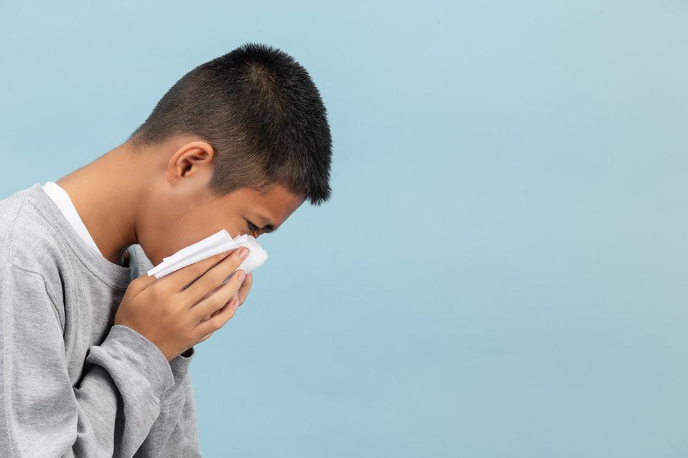 boy-is-sneezing-into-tissue-feeling-sick