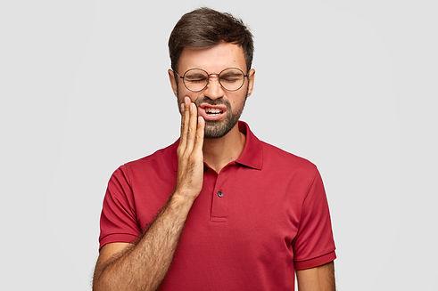 photo-caucasian-man-suffers-painful-toot
