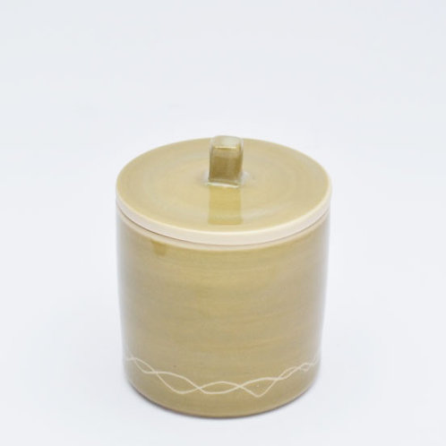 Muted green container with lid