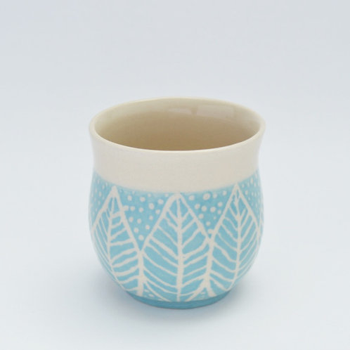 Turquoise pot with leaf design