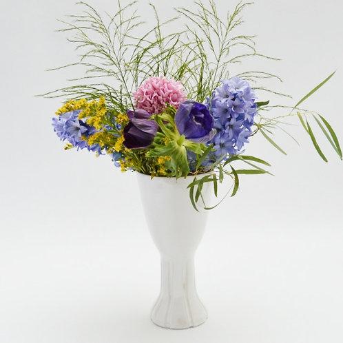 White fluted base vase