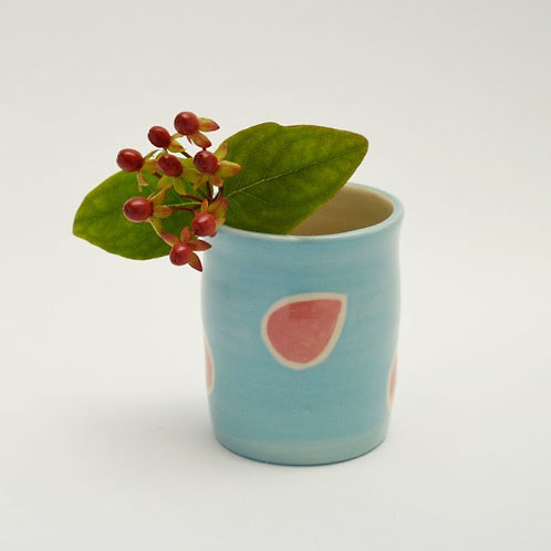 Turqouise pot with red leaf design